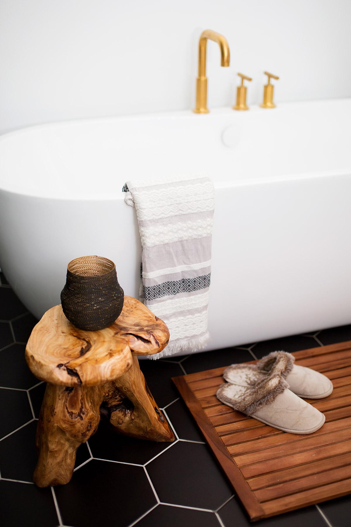Freestanding tub in midcentury modern master bathroom