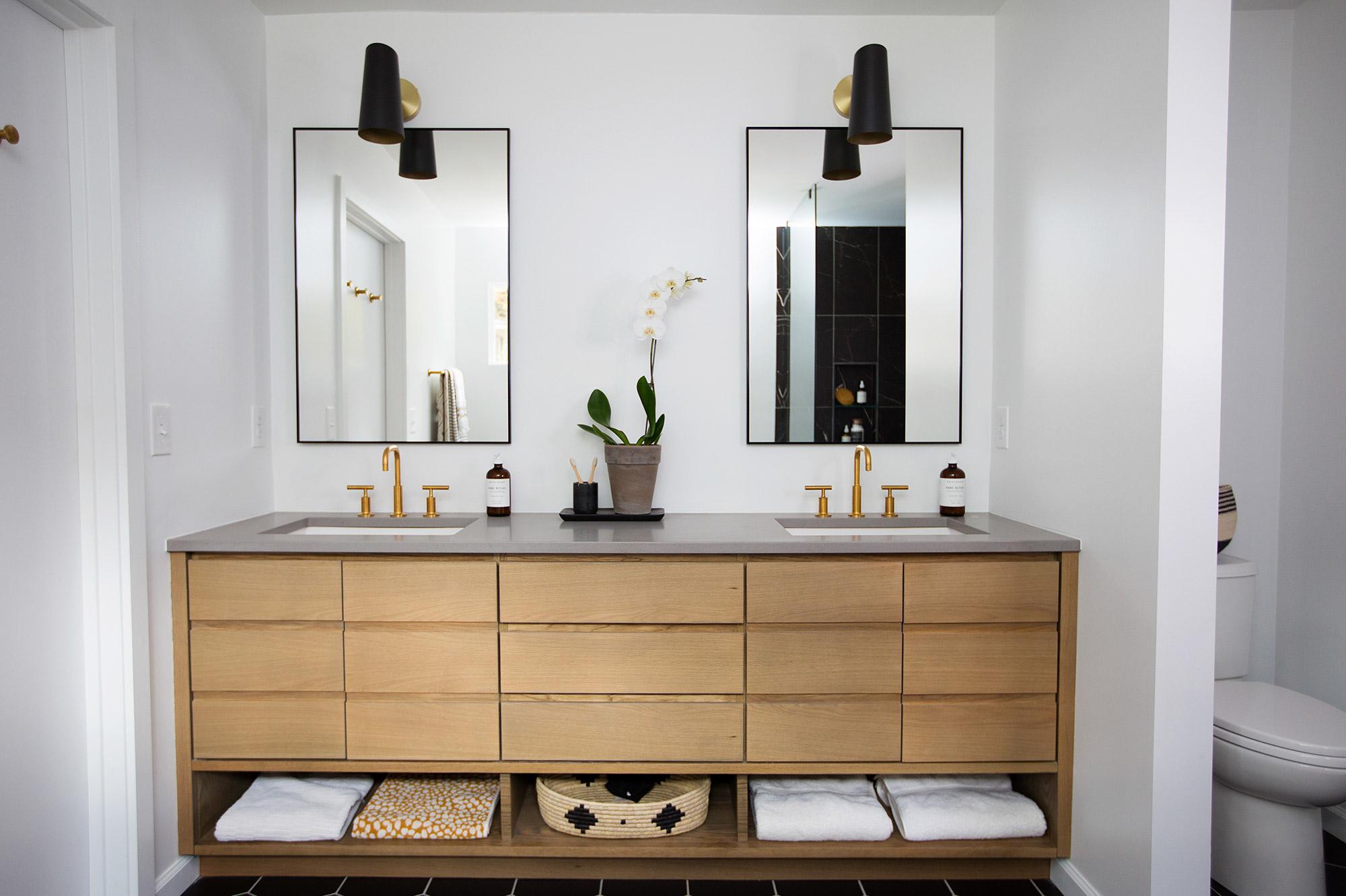 Built-in wood vanity in midcentury modern master bathroom