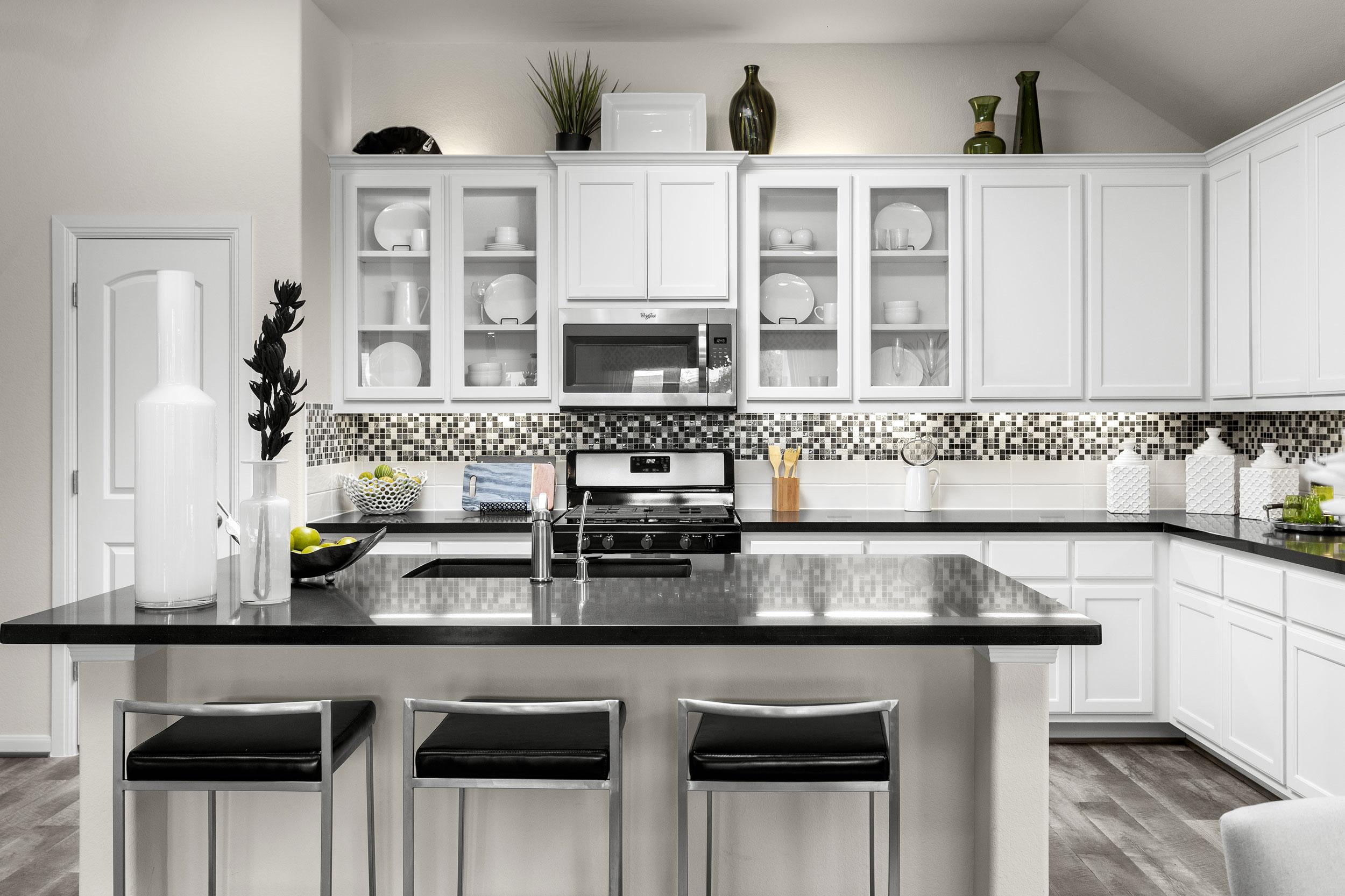 kitchen-design-white-cabinets-black-countertops.jpg