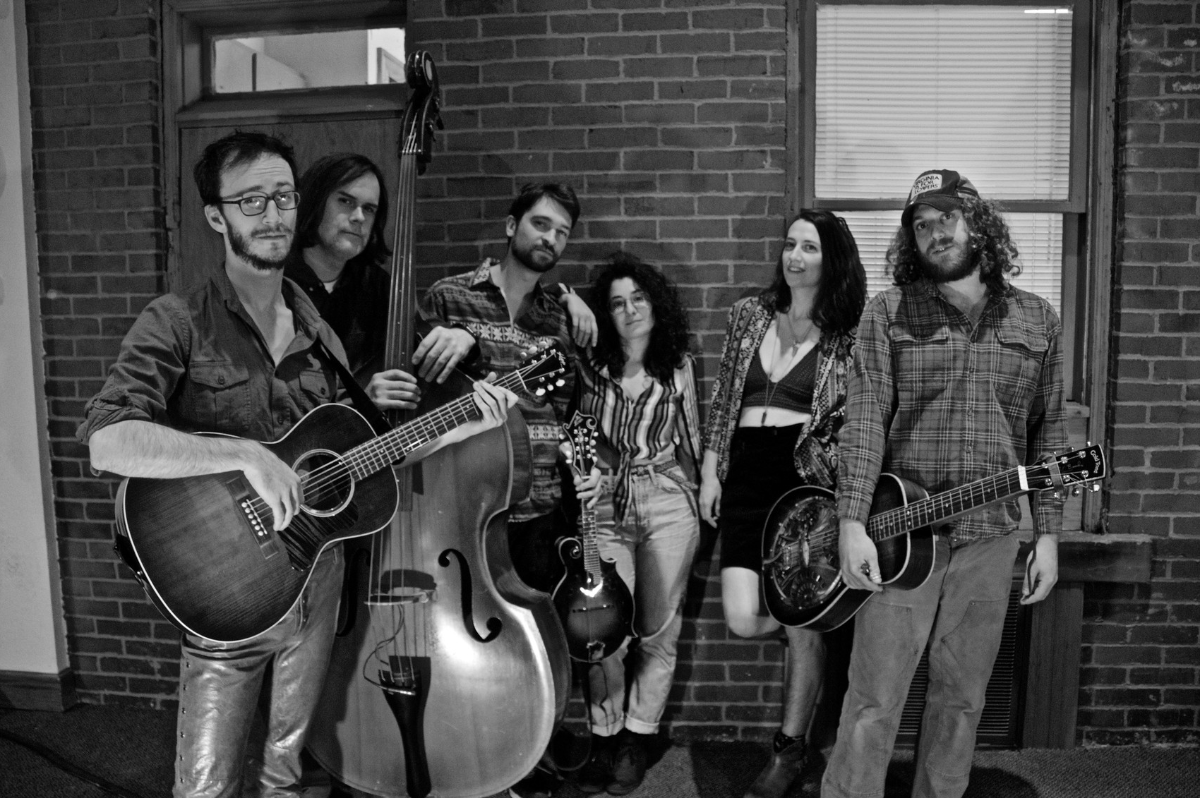 Buffalo Rose - Formed in Pittsburgh, PA in 2016, the group blends folk, soul, and bluegrass into something amorphously Americana, but decidedly their own. Three prominent singers (Shane McLaughlin, Lucy Clabby, and Rosanna Spindler) provide stunning vocal harmonies over dynamic, engrossing layers of stringed instruments. Specifically, acoustic guitar (McLaughlin), upright bass (Jason Rafalak), mandolin (Bryce Rabideau), and dobro (Malcolm Inglis.) Their sharp sense of rhythmic experimentation and evocative, storytelling lyricism come together for a sound with both shimmer and punch; it's foot-tapping and breathtaking in turn. Buffalo Rose offers a warm, passionate homage to America's classic musical traditions, with modern twists that keep things interesting—and damn fun.