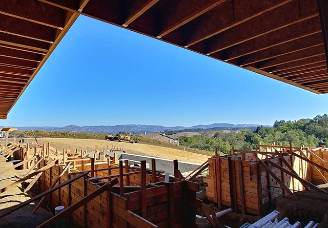 One of the most exciting parts of watching a building come out of the ground is seeing it within its context. Seeing the great extent of the surrounding rolling hills. Seeing the large eaves frame the beautiful view. Seeing the relationship between the built and the natural. . . . #context #construction #framedview #architect #architecting #archdaily #arch  #residential #archlover #architizer #exterior #exteriordesign #modernfarmhouse #modern #modernarchitecture #napa #pasorobles #slo #sanluisobispo #centralcoast #hamblyhomes