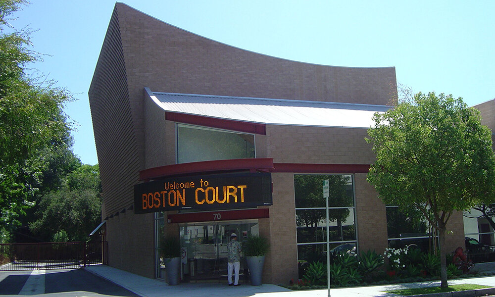 """Boston Court Theatre - Pasadena, CA (while @ Li & Associates)Structural design of this new (9,363 sq. ft.) performing arts building. The walls are concrete block, the floors are wood with engineered joists and the roofs over the office spaces are glu-lam beams with a engineered joists. The roofs over the stage and theatre seating is custom steel trusses with a concave top chord. They are insulated with a concrete filled roof deck 6"""" thick. Special details include a large loft in the main entrance supported by tensions rods to the roof, a catwalk system around the theatre that cantilevers of the block walls, and on wall that dramatically leans outward 1"""" per course of block."""