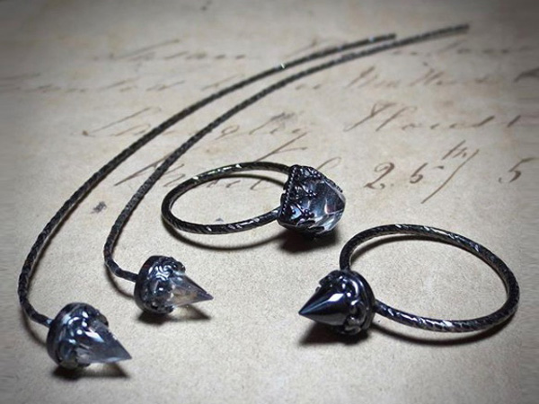 'Comet' earrings and temple rings by Odette