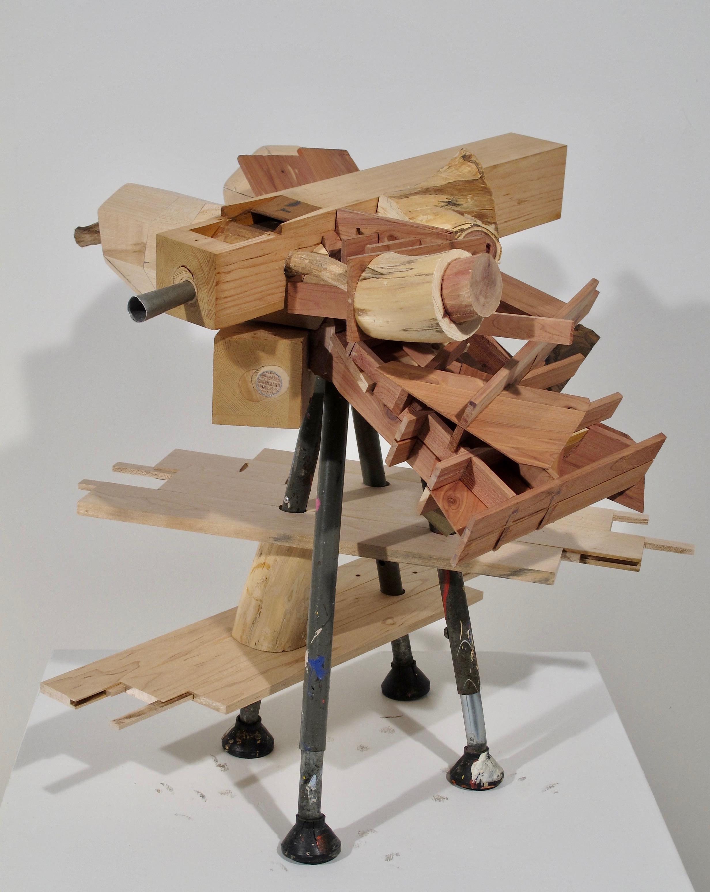 "Mid-Winter,  2019   wood, steel, rubber 23"" x 25"" x 23"""