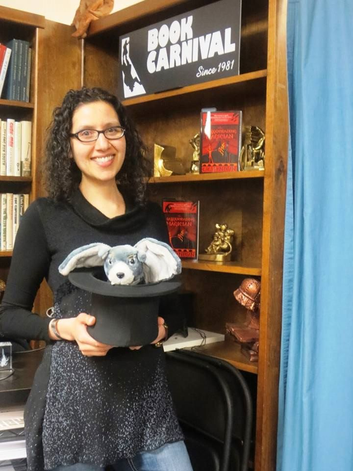 That's Dori the gargoyle in my magician's hat, before my book Q&A and magic act at Book Carnival in Orange.