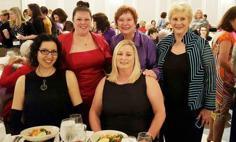 Celebrating with Cindy Brown (in purple) for her Agatha nomination for her debut mystery, MacDeath. With Priscilla Caporaletti-Bean, Susan Boyer, Cindy Brown, and Nancy West.