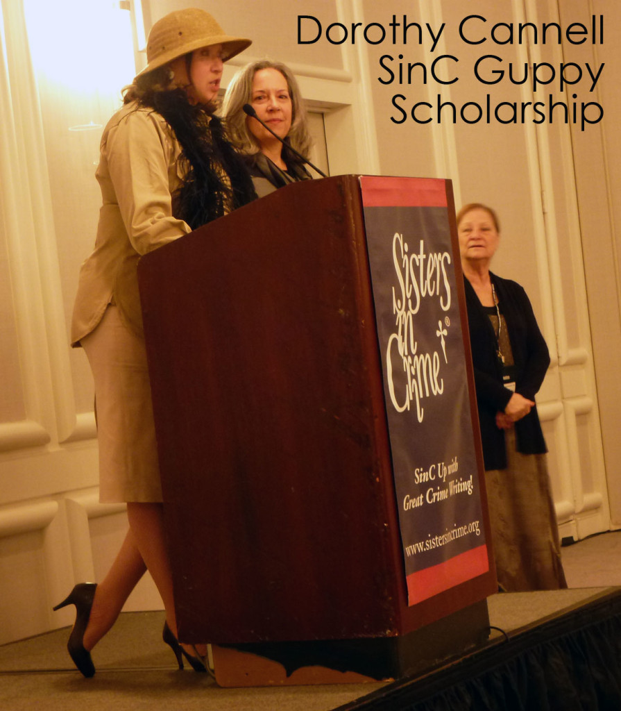 Diane Vallere presenting this year's Dorothy Cannell Guppy Scholarship, which pays for a member of the Guppy Chapter of SinC to attend Malice Domestic.