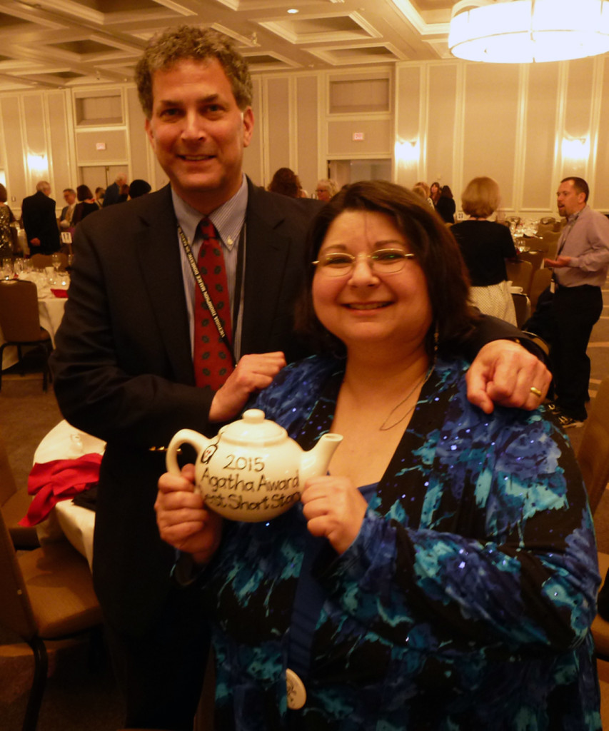 Dan Stashower with Barb Goffman and her Agatha Award for Best Short Story.