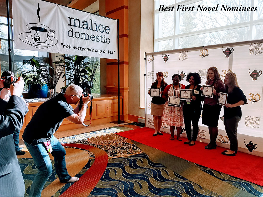 After the opening ceremonies, a behind the scenes look at the photo shoot of the Best Debut Novel nominees! Micki Browning, VM Burns, Kellye Garrett, Kathleen Valenti, and Laura Oles.