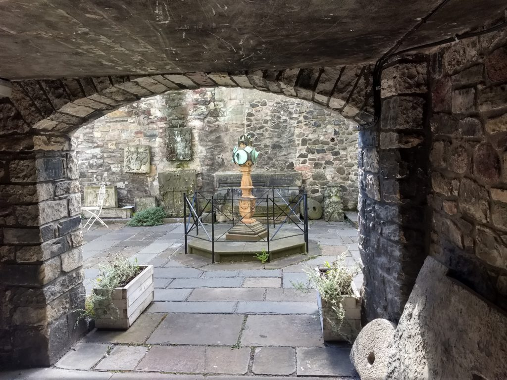 A secret courtyard filled with ruins that have been rescued from various parts of the city when old buildings are demolished! This hidden gem is behind the Museum of Edinburgh, and a fictionalized version made its way into my manuscript.