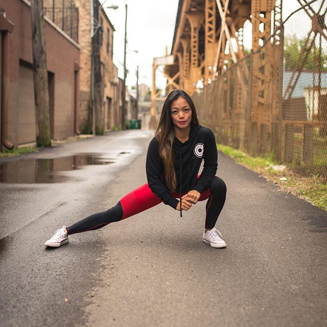 Out here, in a random alley getting a good stretch in to seize the day. 🧘🏽♀️- @cdfitness.chi