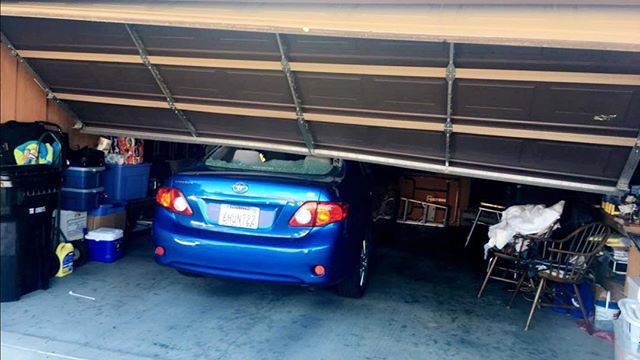 Garage Door is broken and off track ?! We can fix it  for you . Give us a call 714.749.3262 #garagedoorrepair #garagedoorservice garaged#garagedoorservice #losangeles #shermanoaks