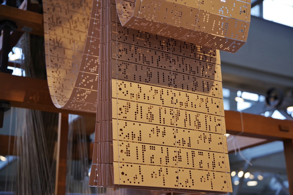 Jacquard Loom punch cards used to store detailed pattern information for textile weaving.