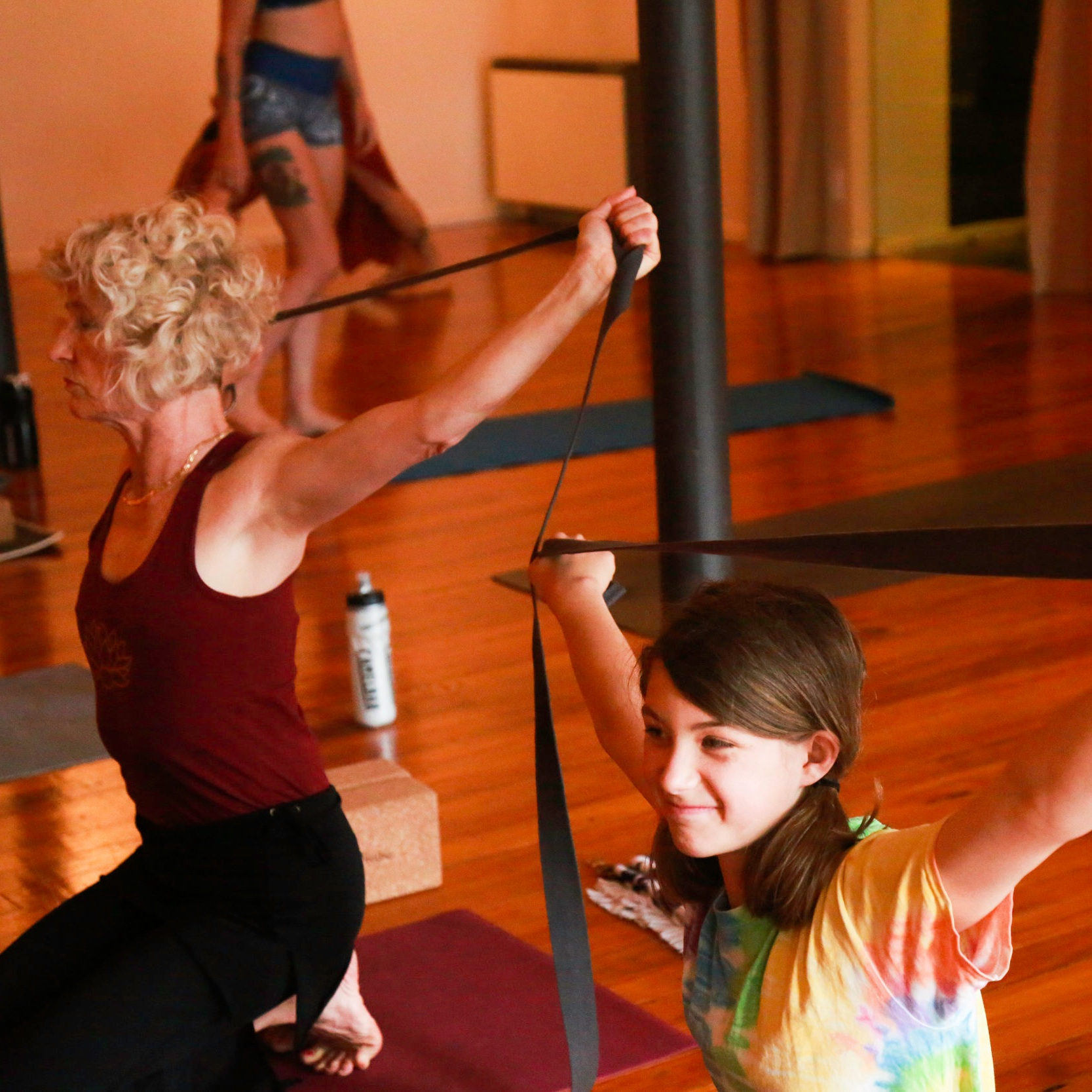 yoginis with straps
