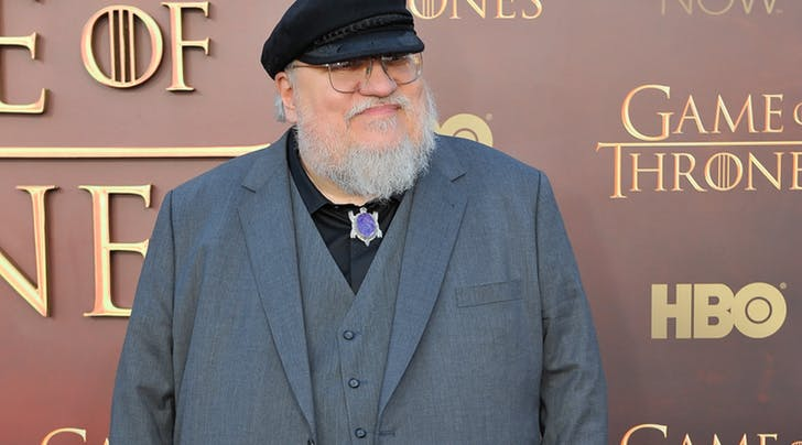George_R.R._Martin_in_front_of_Game_of_Thrones_Backdrop.jpg