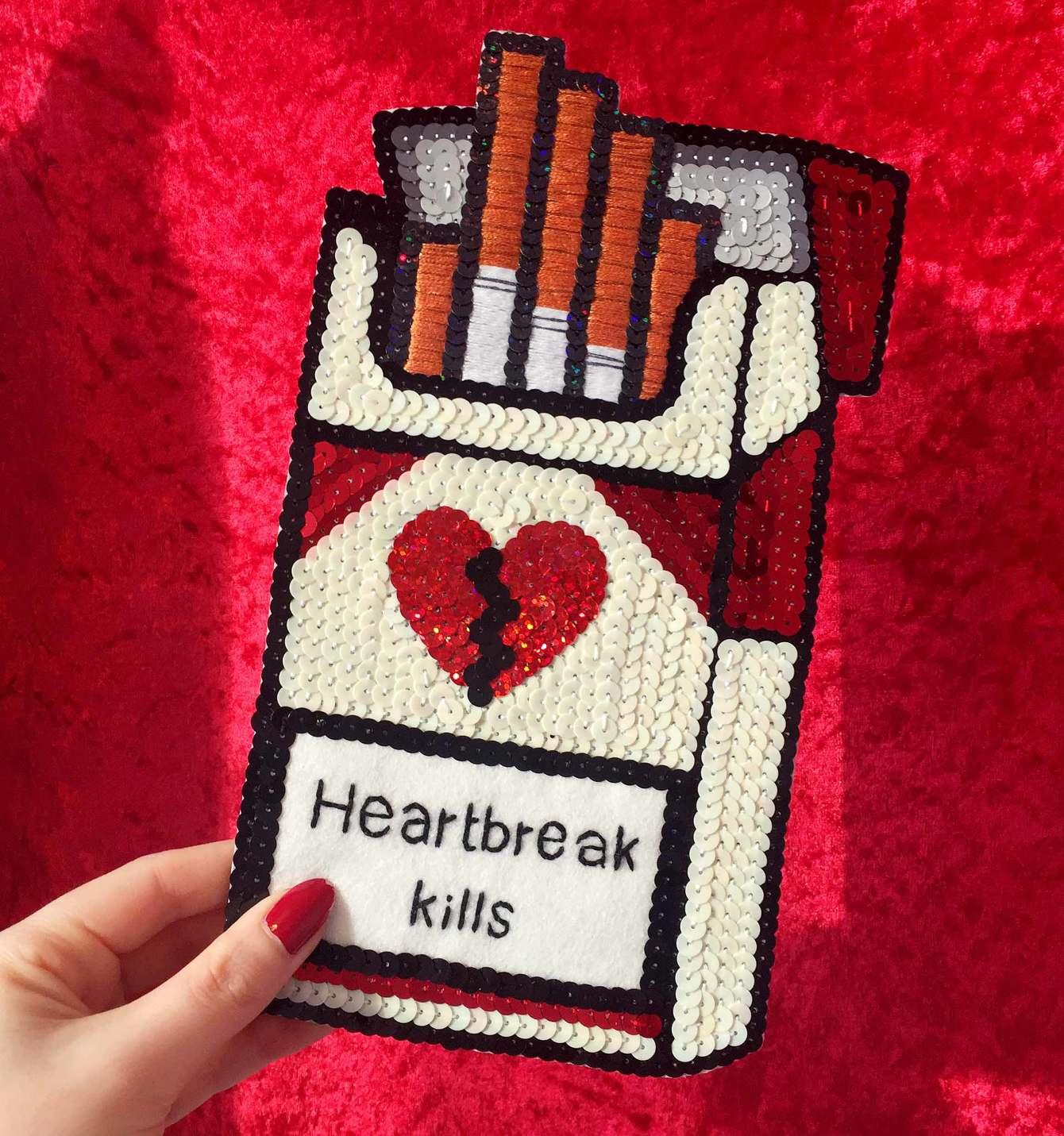 "embroidered sequin ""heartbreak kills"" cigarette pack, 2016, Sophie King"