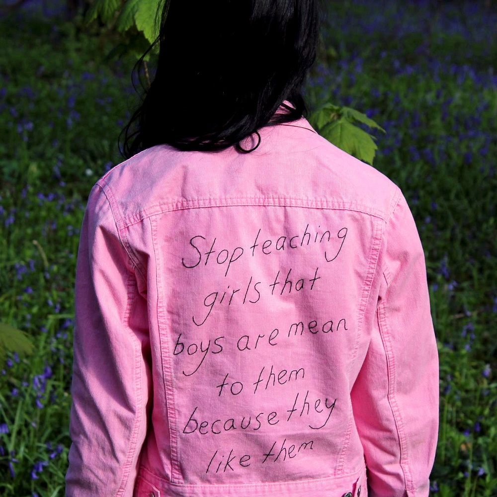 """stop teaching girls that boys are mean to them because they like them"" embroidery on denim jacket, 2016, Sophie King"