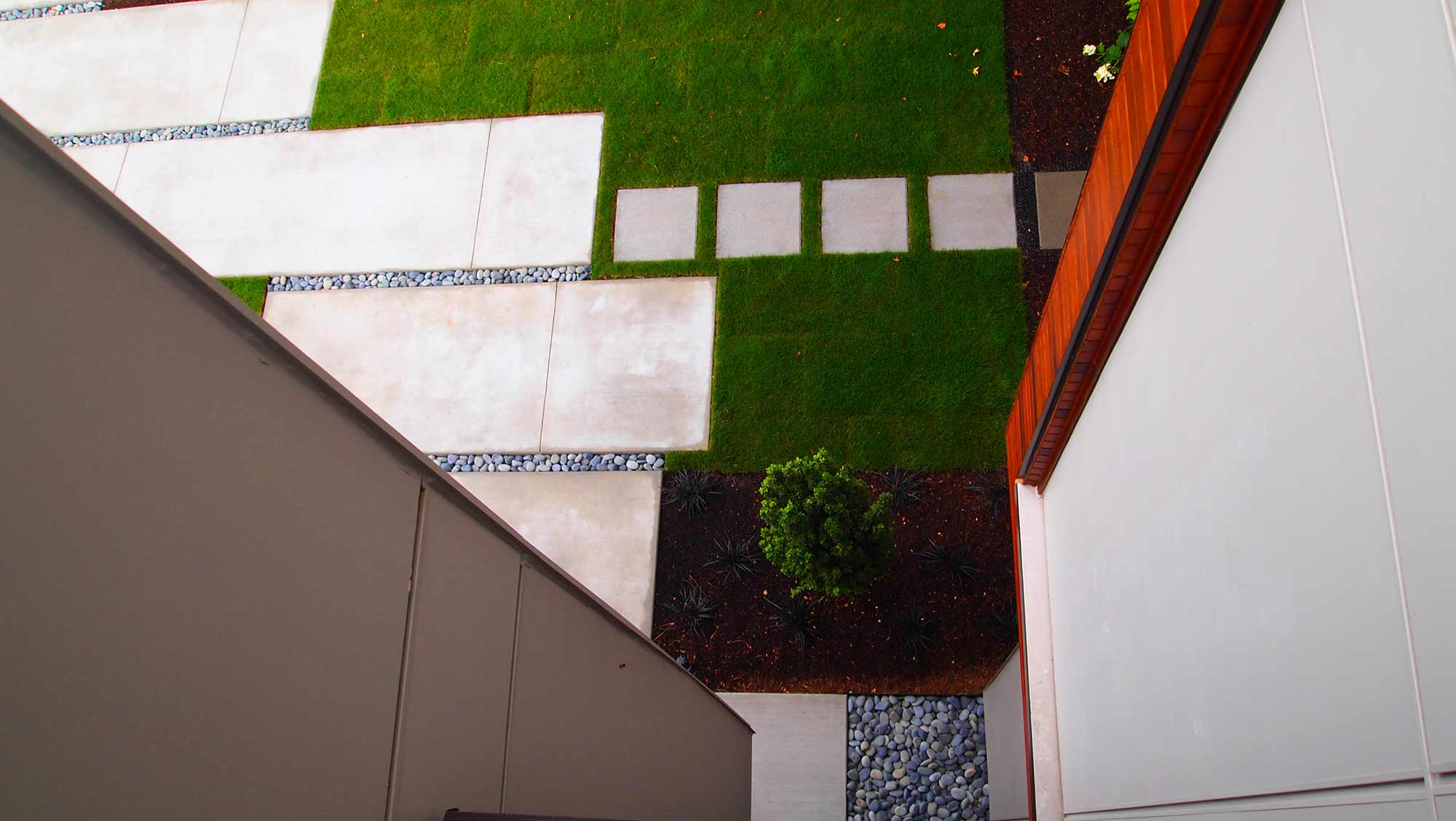 LARGE SCALE FLOATING CONCRETE PADS INTERLOCKING WITH LAWN TO CREATE AND ELEGANT ENTRY