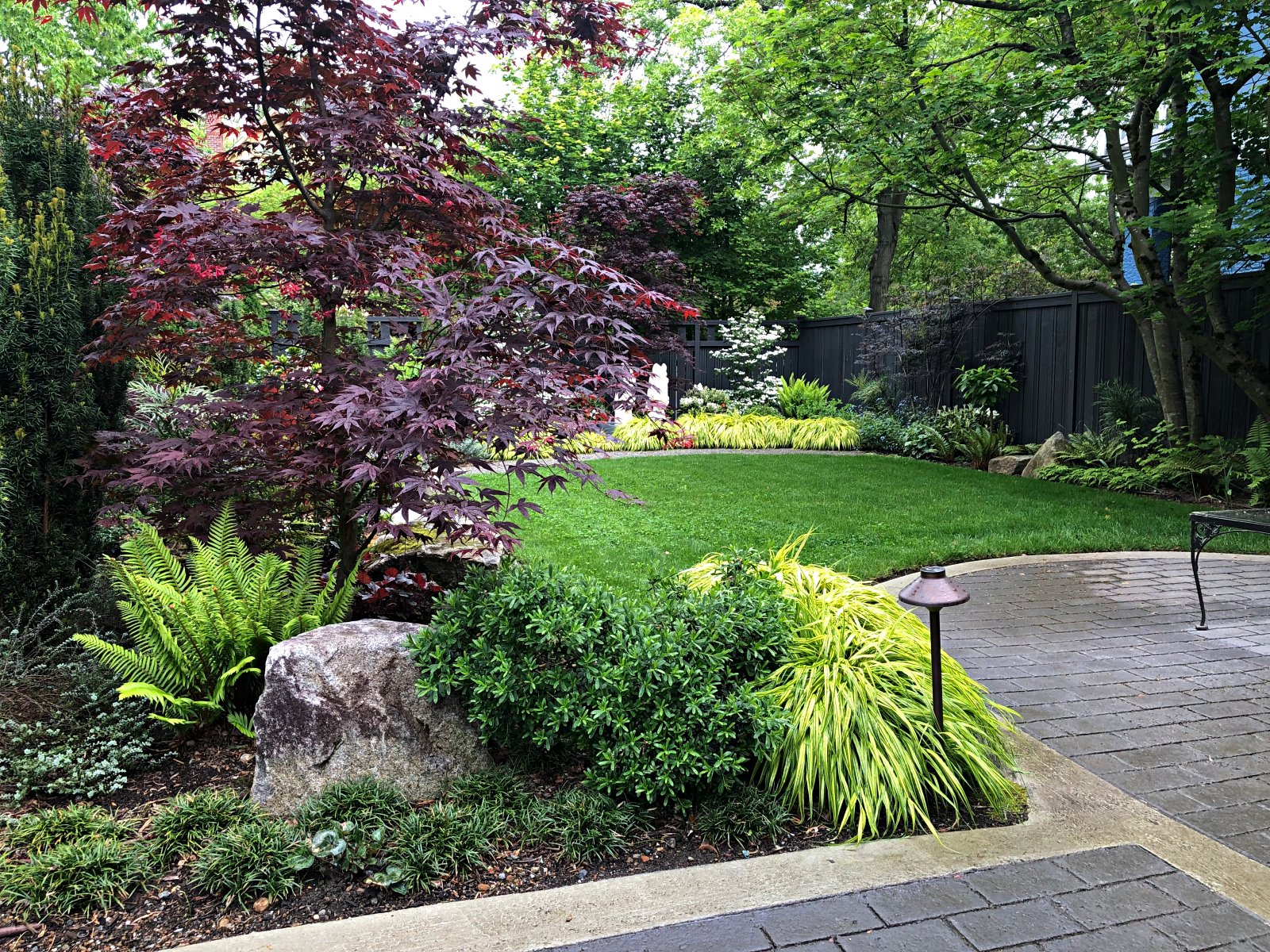 WOODLAND THEME IS CARRIED THROUGHOUT GARDEN TO CREATE CALM