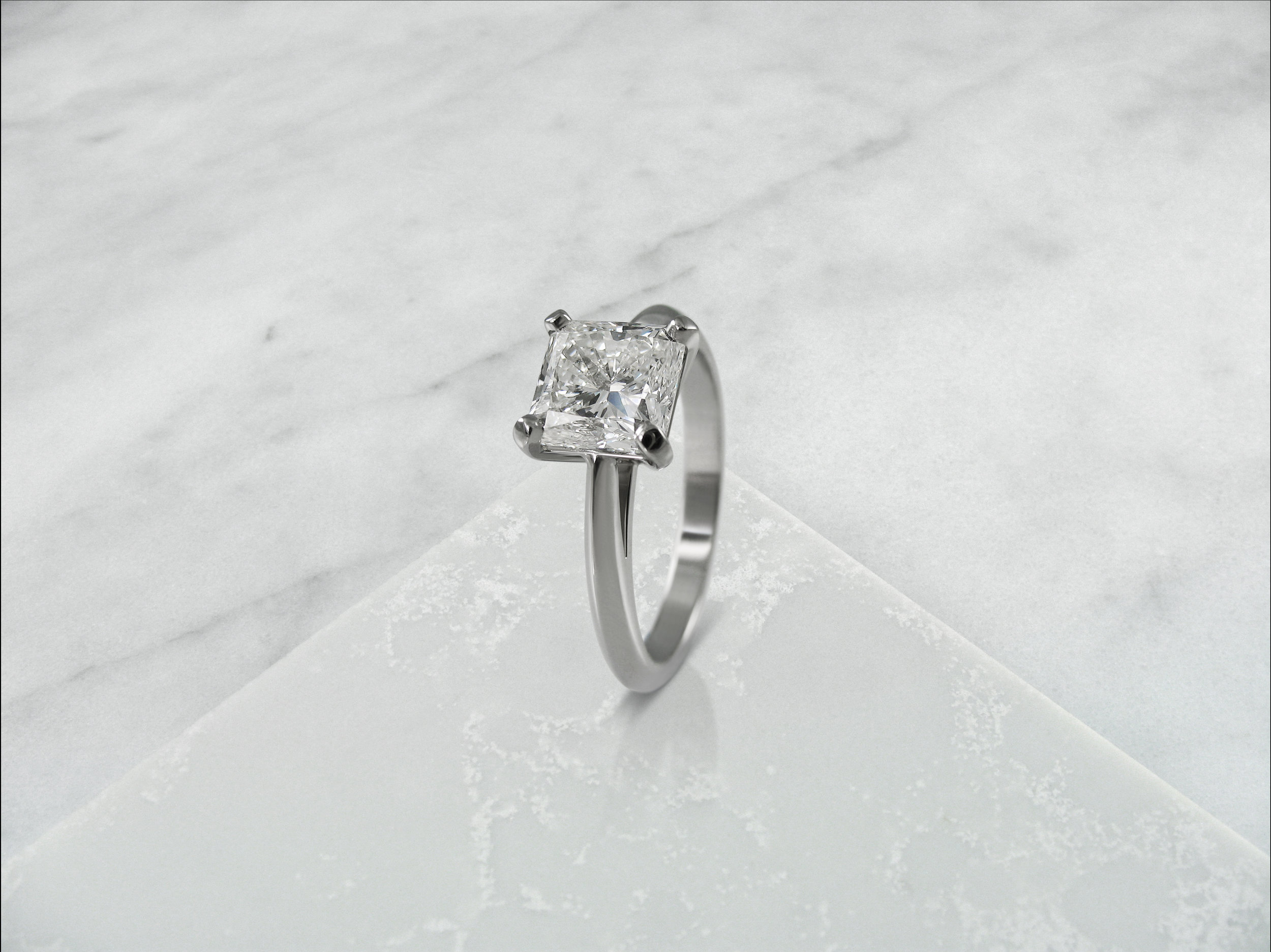 Radiant cut diamond four claw solitaire engagement ring