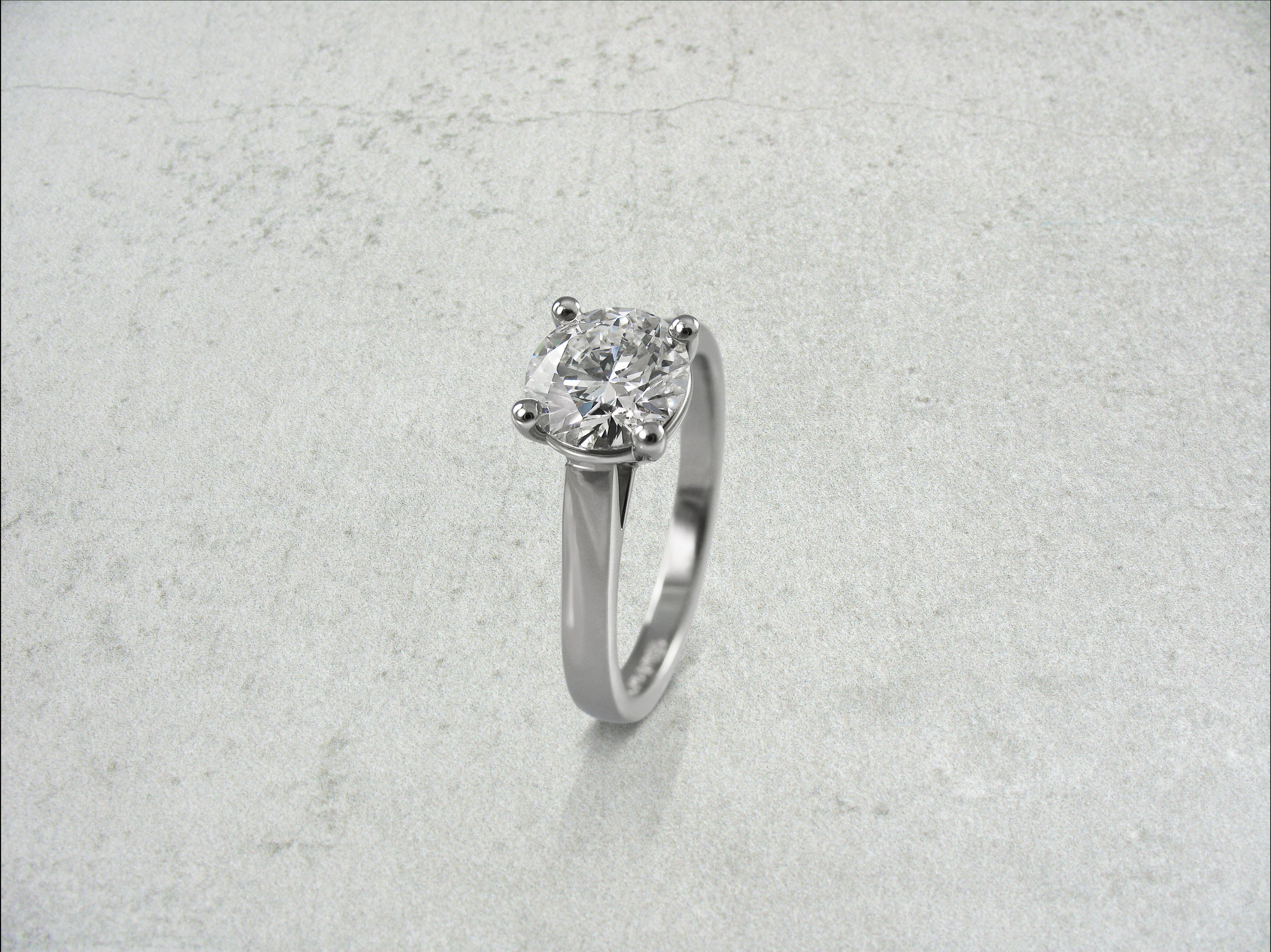 Round brilliant cut diamond four claw solitaire engagement ring