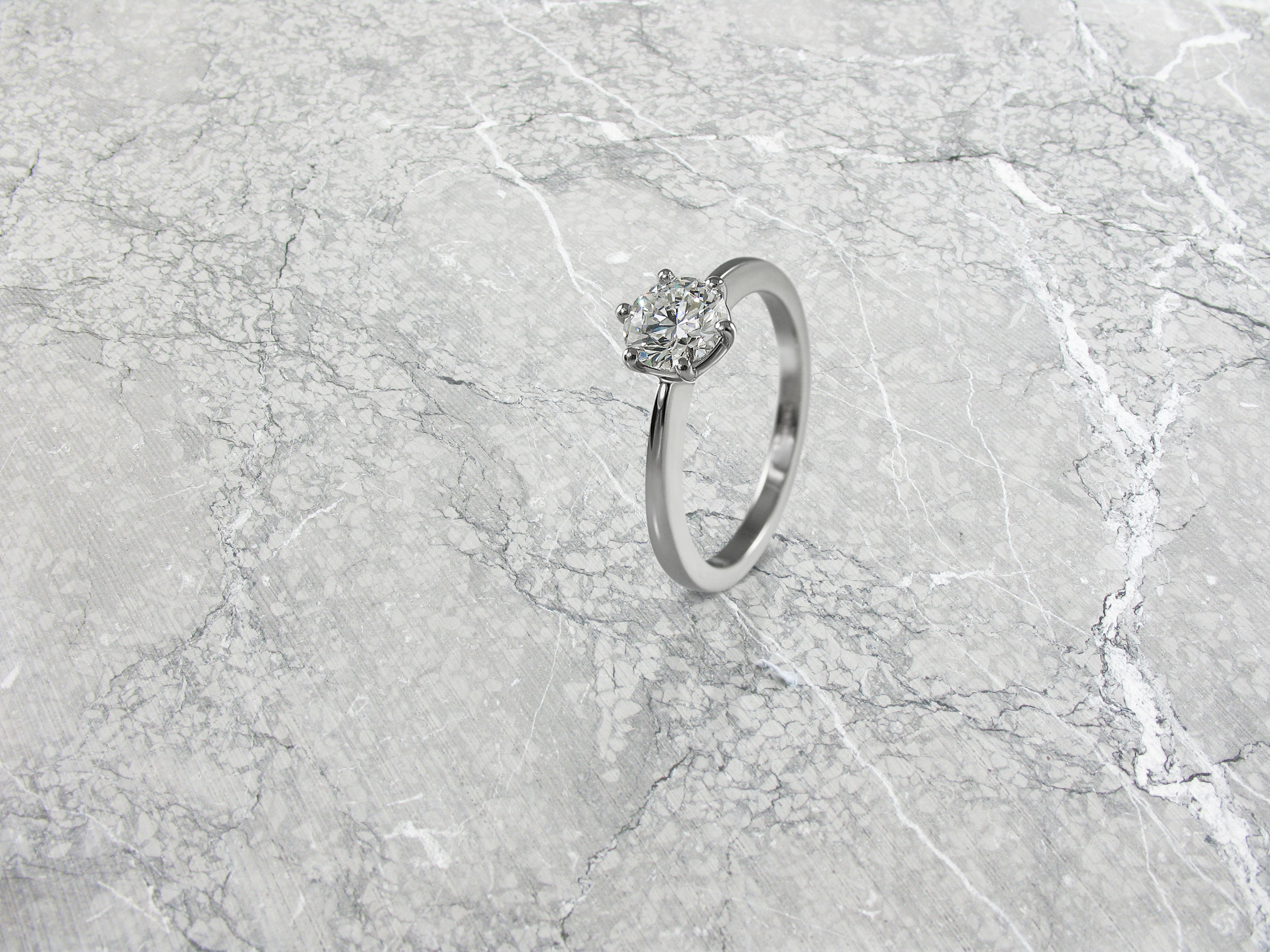 Round brilliant cut diamond six claw solitaire engagement ring