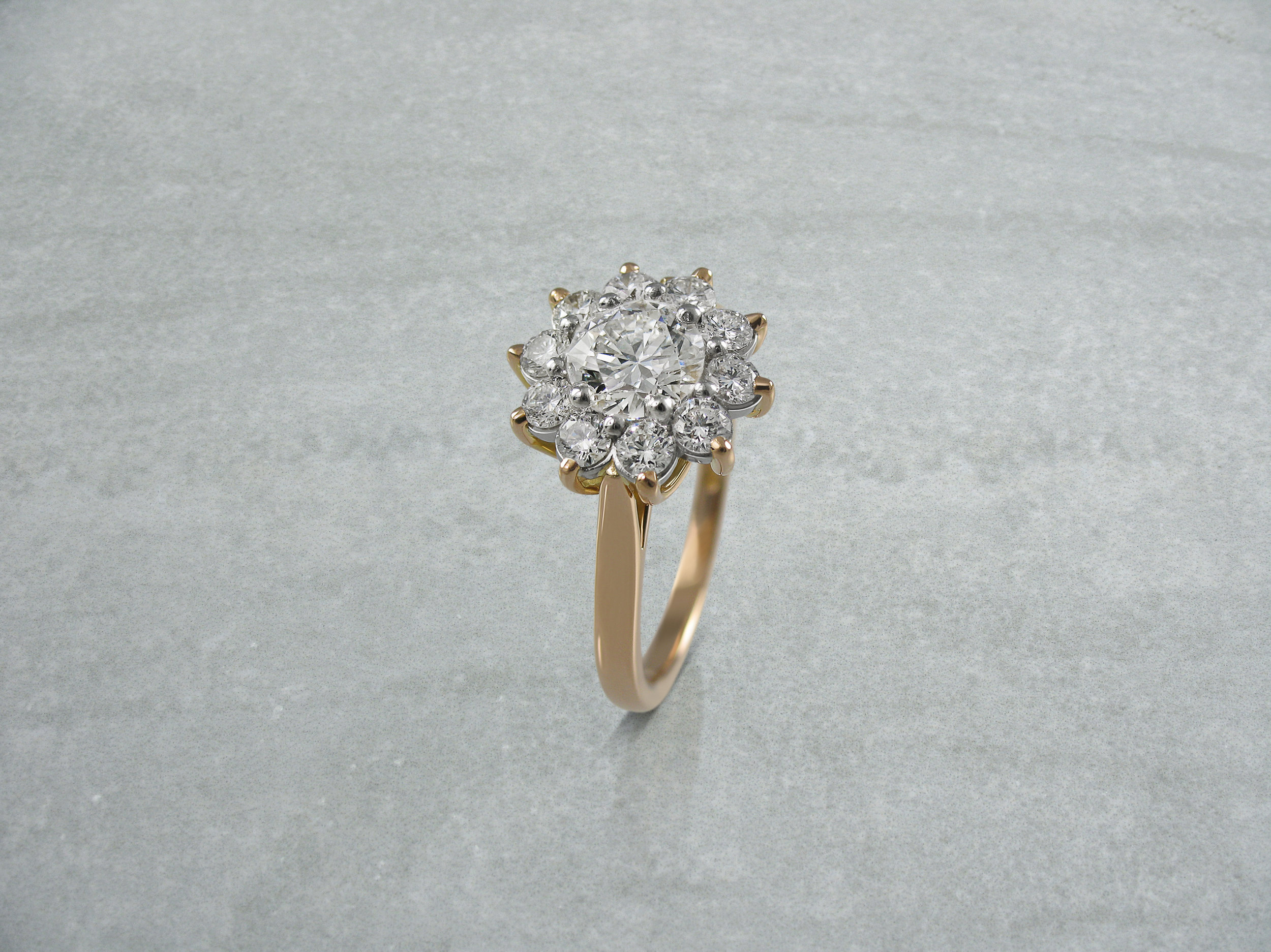 Round brilliant cut diamond rose gold cluster engagement ring