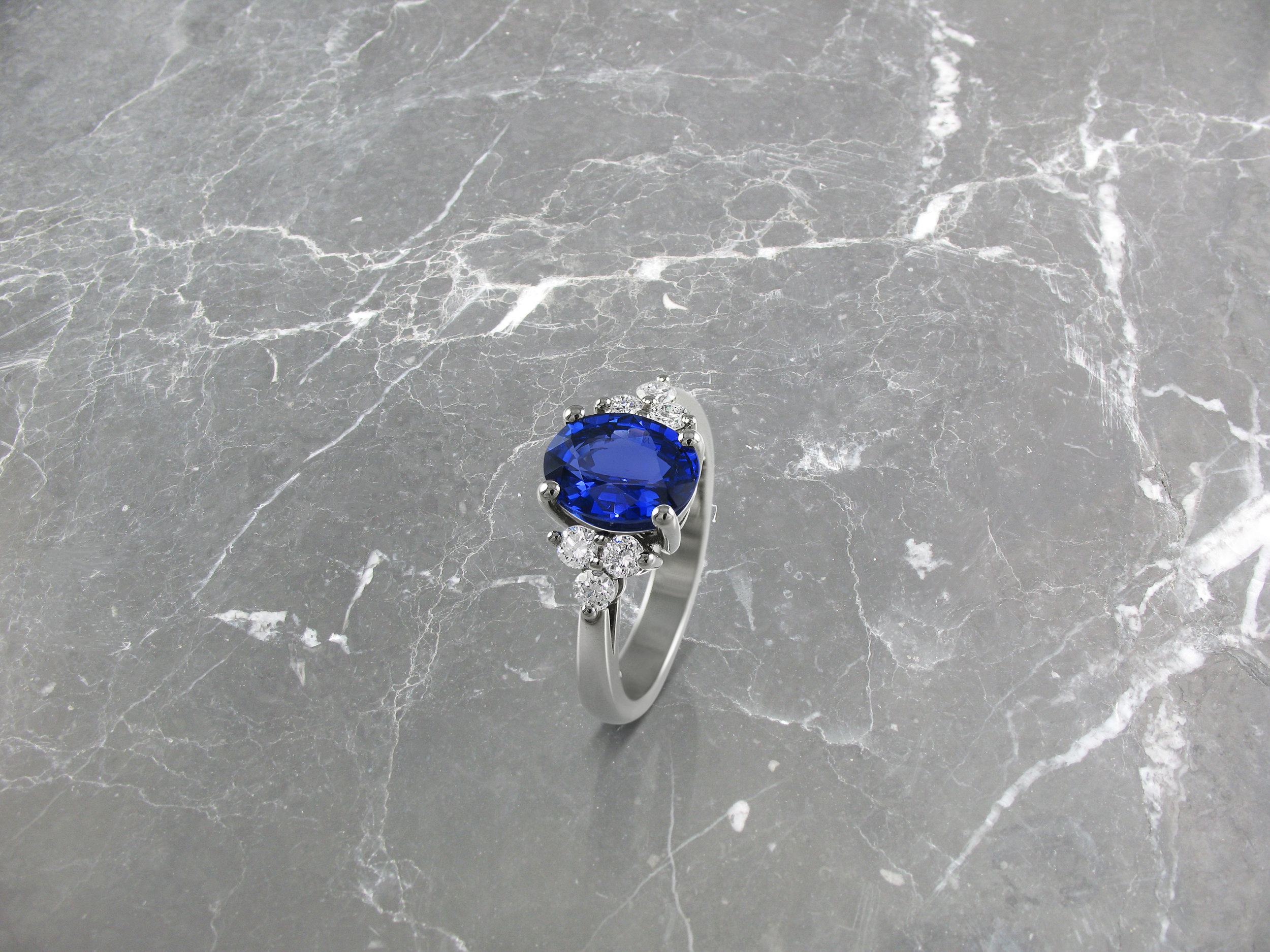 Oval sapphire and diamond trefoil engagement ring
