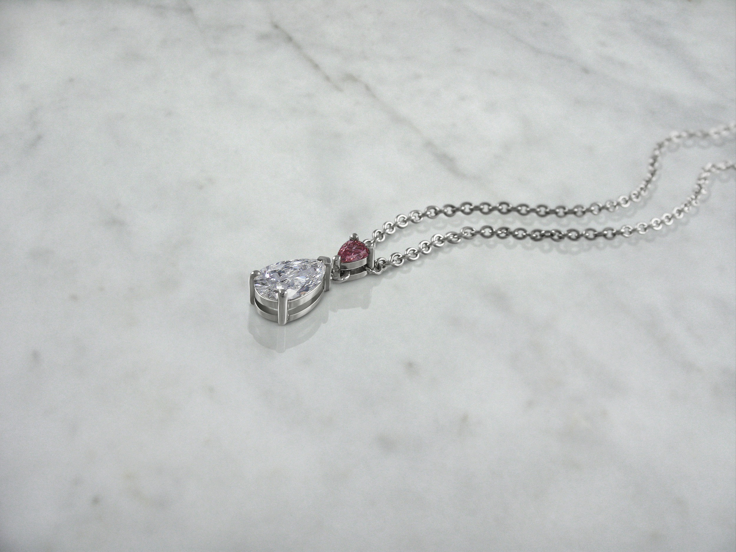 Pear shaped pink diamond and diamond pendant from the Fiorella collection