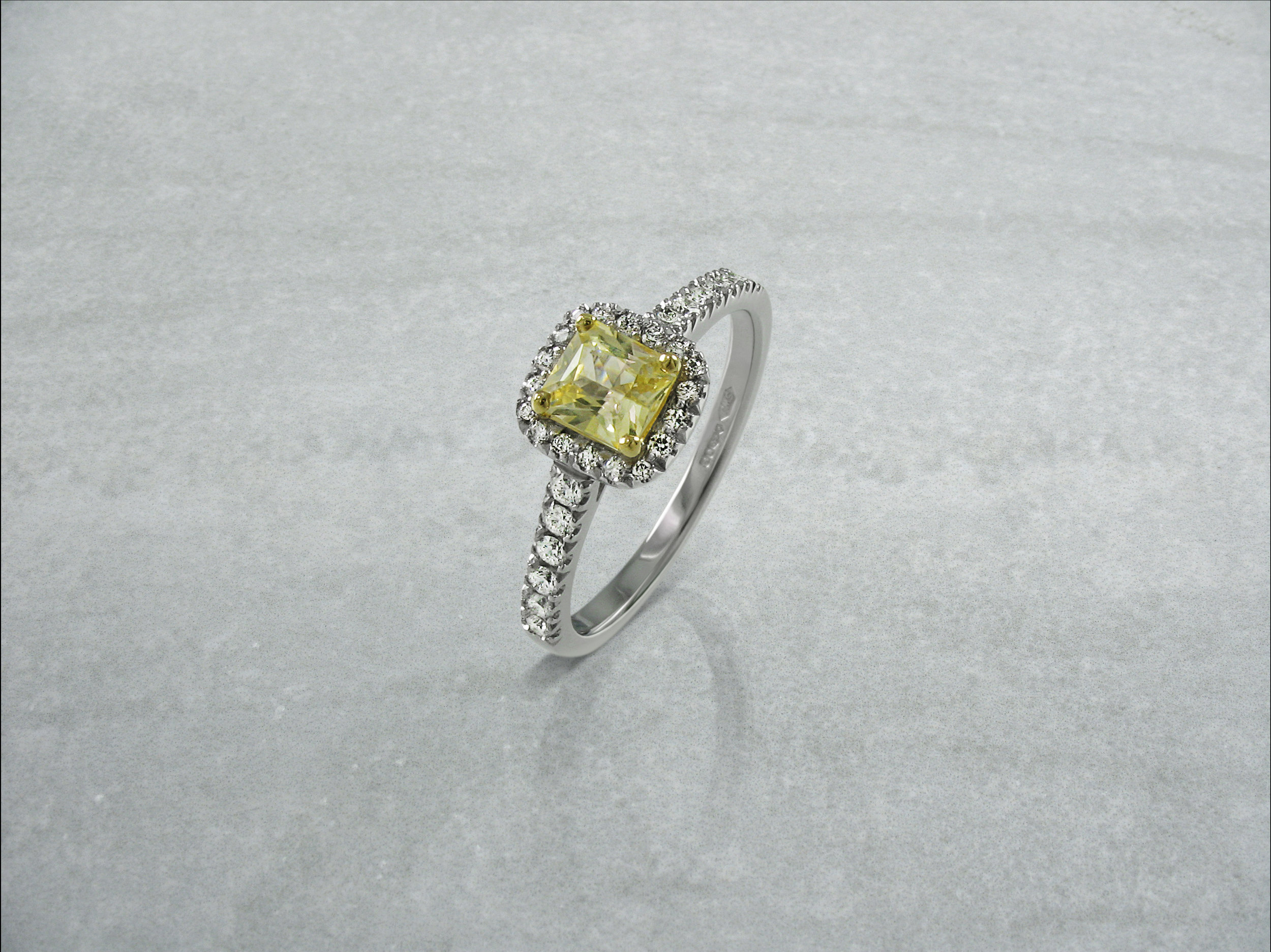 Radiant cut yellow diamond halo engagement ring with diamond band