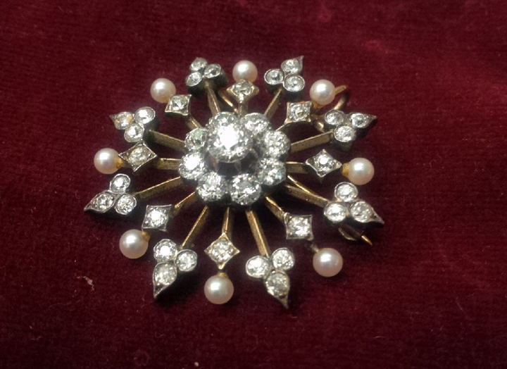 The beautiful antique brooch at the start!