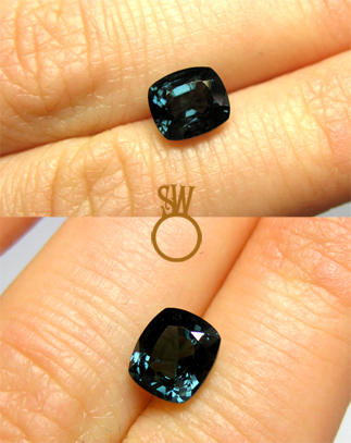 Coloured gemstone on finger Simon Wright