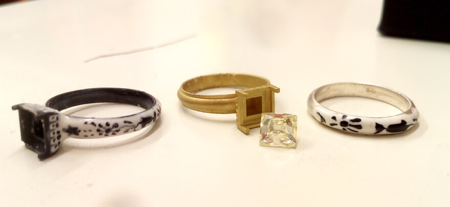 three vintage reproduction rings