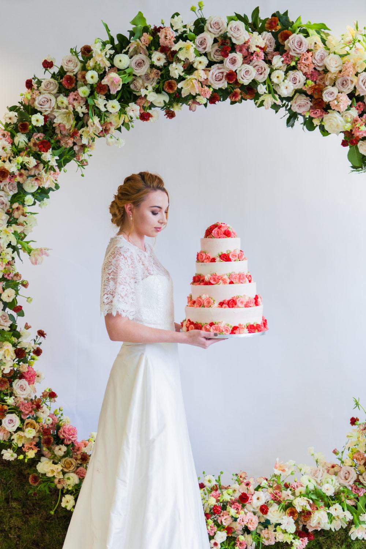 bride holding wedding cake