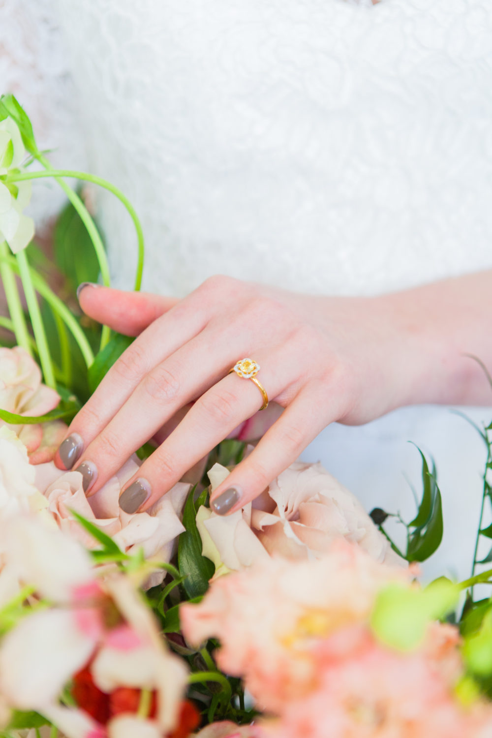 Bride's hands with floral engagement ring AmandaKarenPhotography