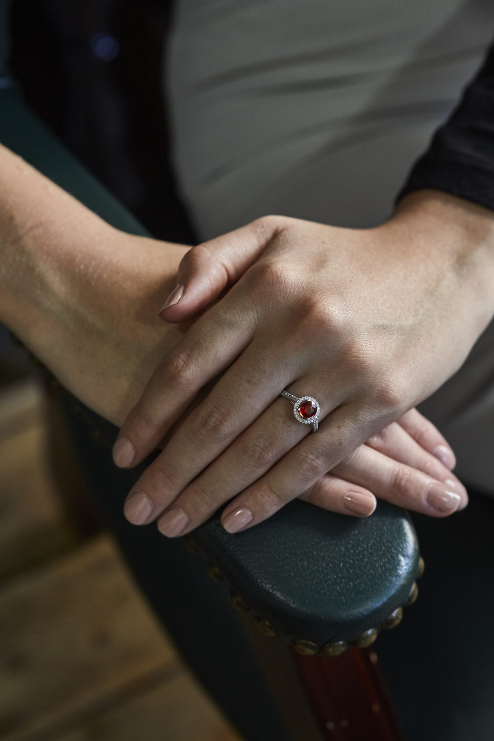 Lady's hands with coloured stone engagement ring.jpg