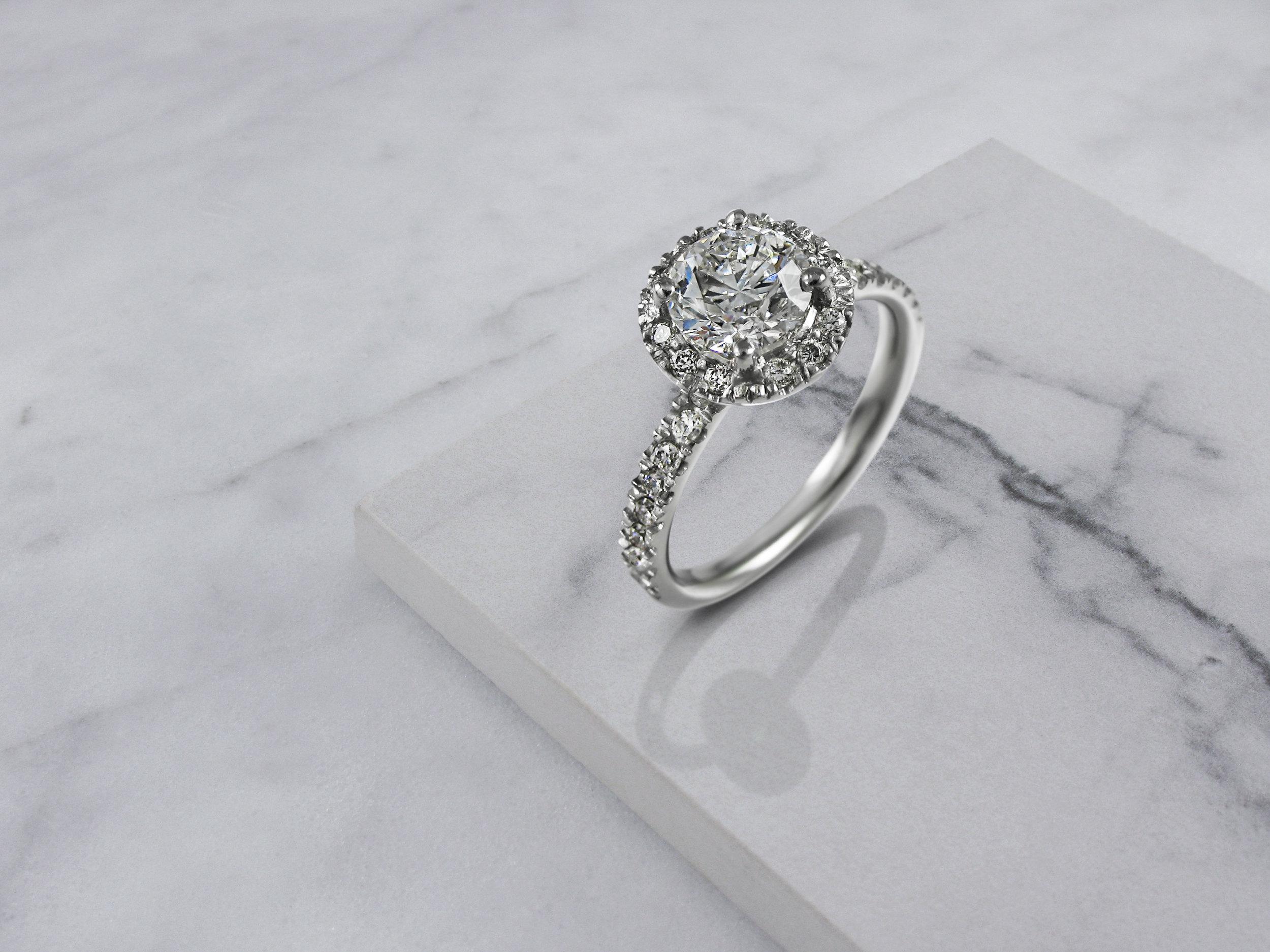 round brilliant cut diamond halo engagement ring 2.jpg