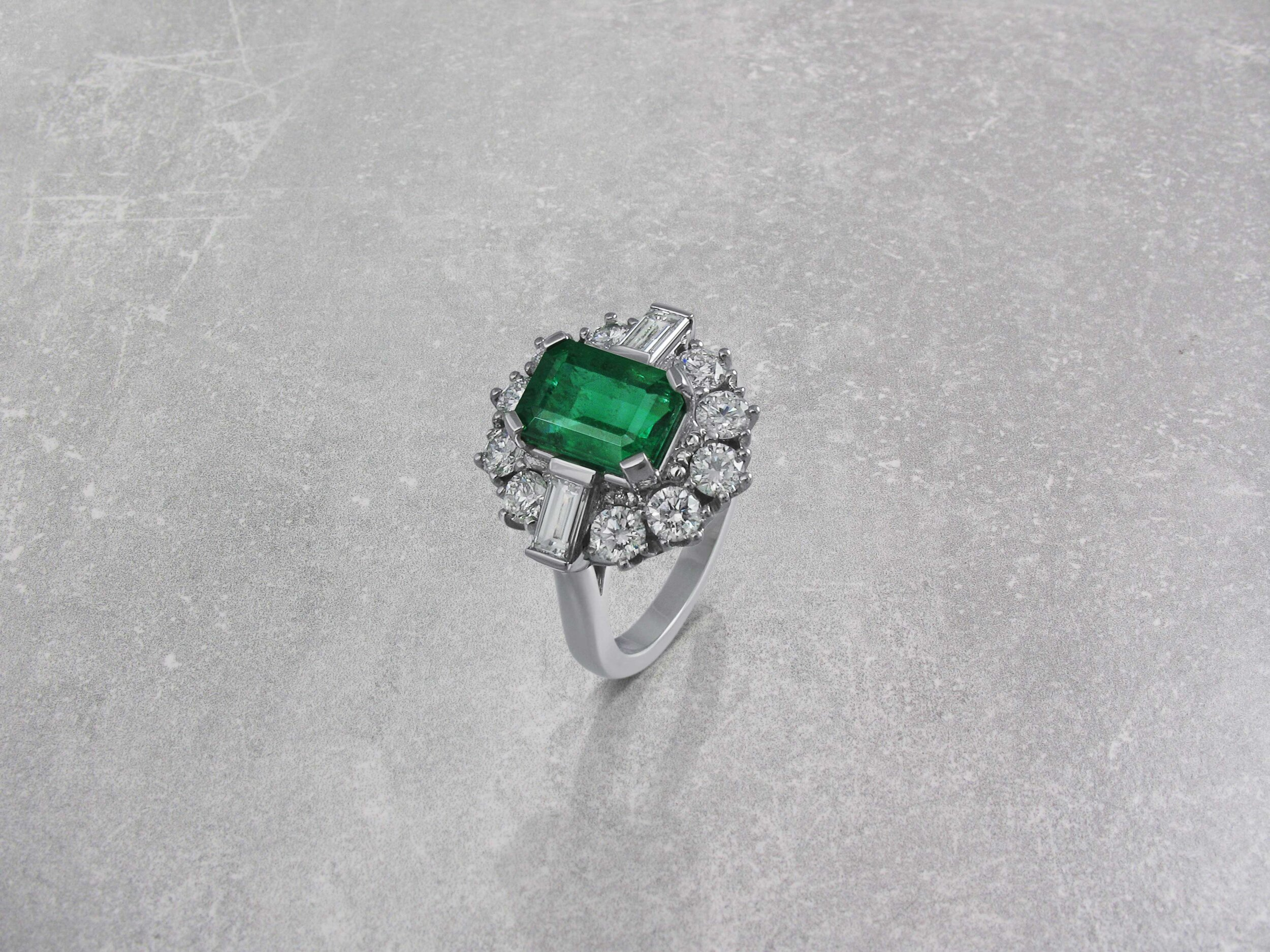 emerald-and-diamond-vintage-style-cluster-ring.jpg