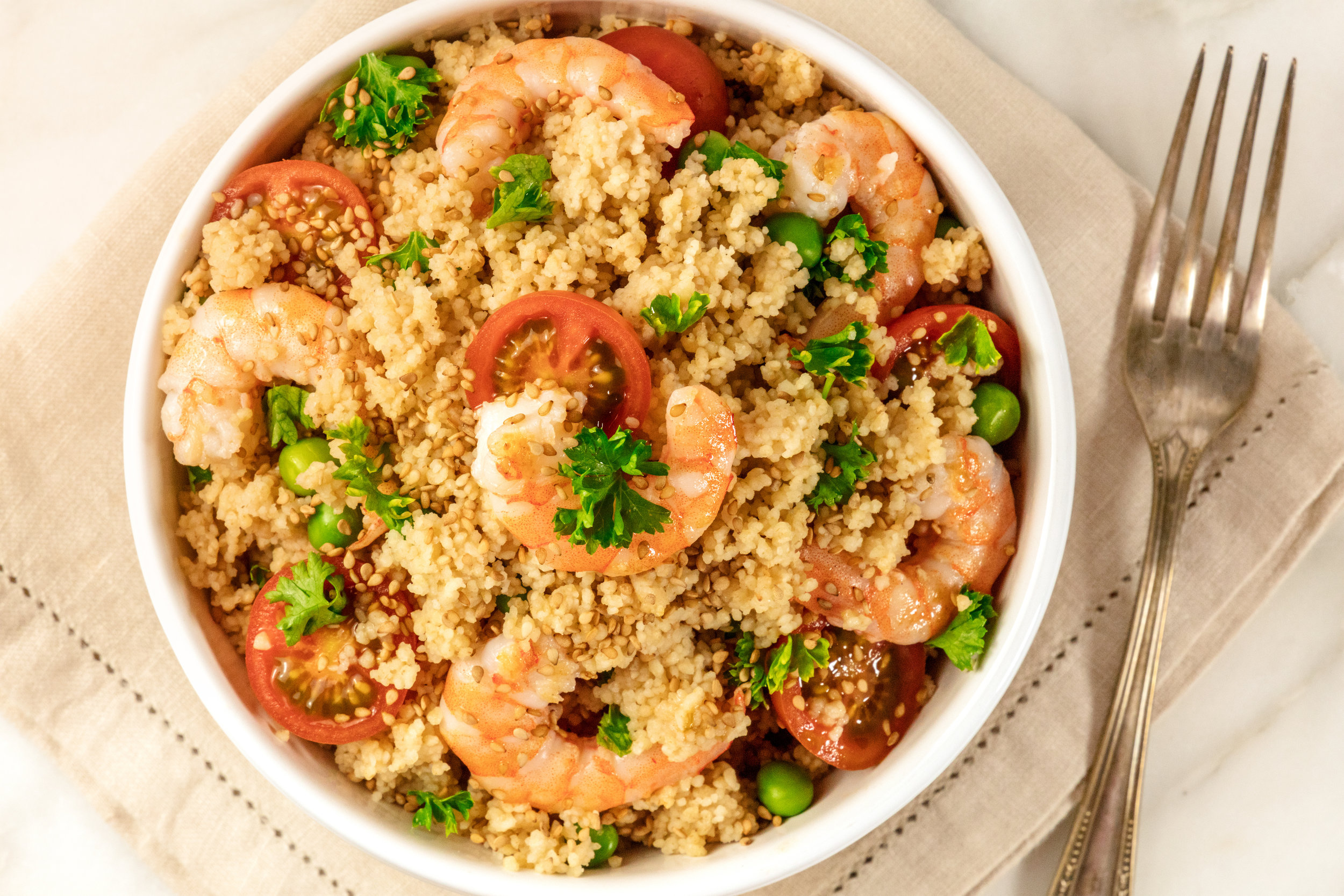 One-pan mediterranean prawn couscous - A sure family favourite.Quick to prepare and cook, and very adaptable. The garnishes can easily be left out and all the fresh ingredients can be switched out for frozen alternatives.Wrap up and refrigerate, and the leftovers will keep well for the next day.