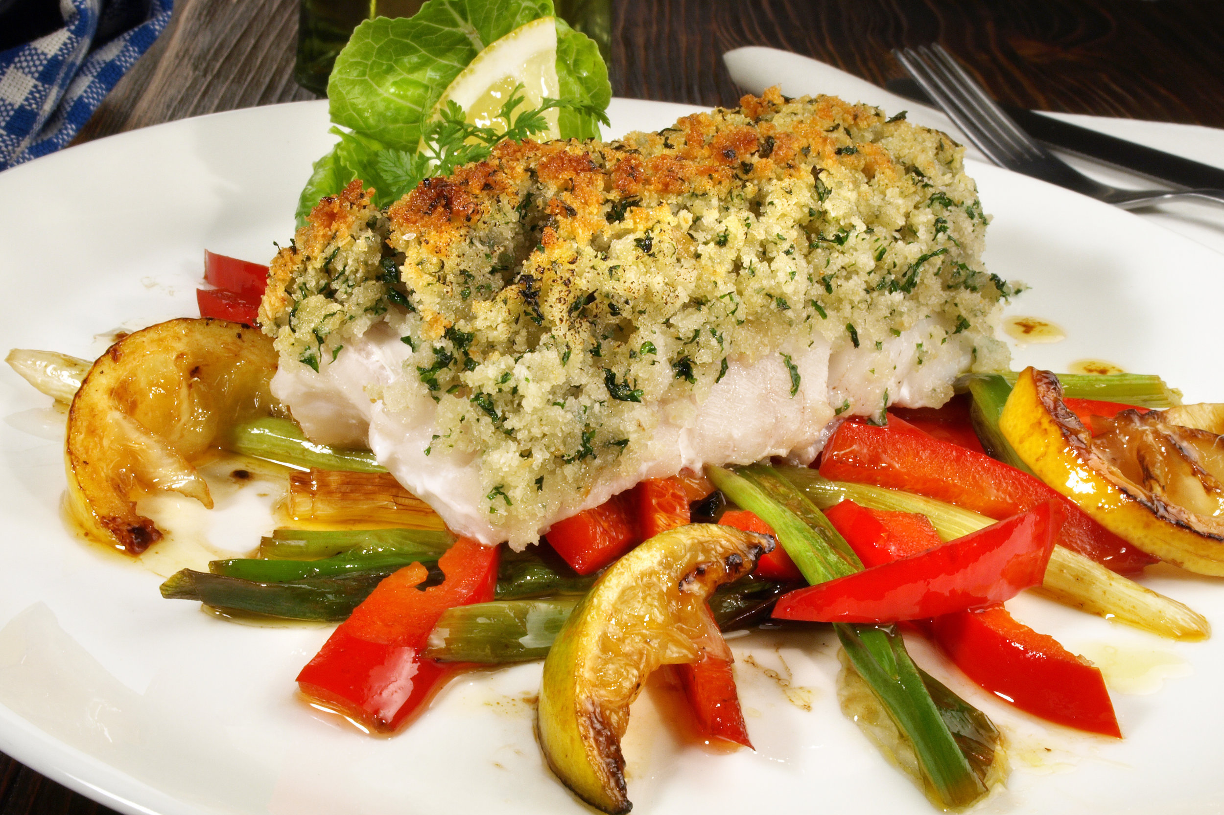 Herb crusted cod with roasted peppers - A great alternative to fish and chips.Tasty home-baked white fish with its own herby crust. Serve with soft and sweet peppers.