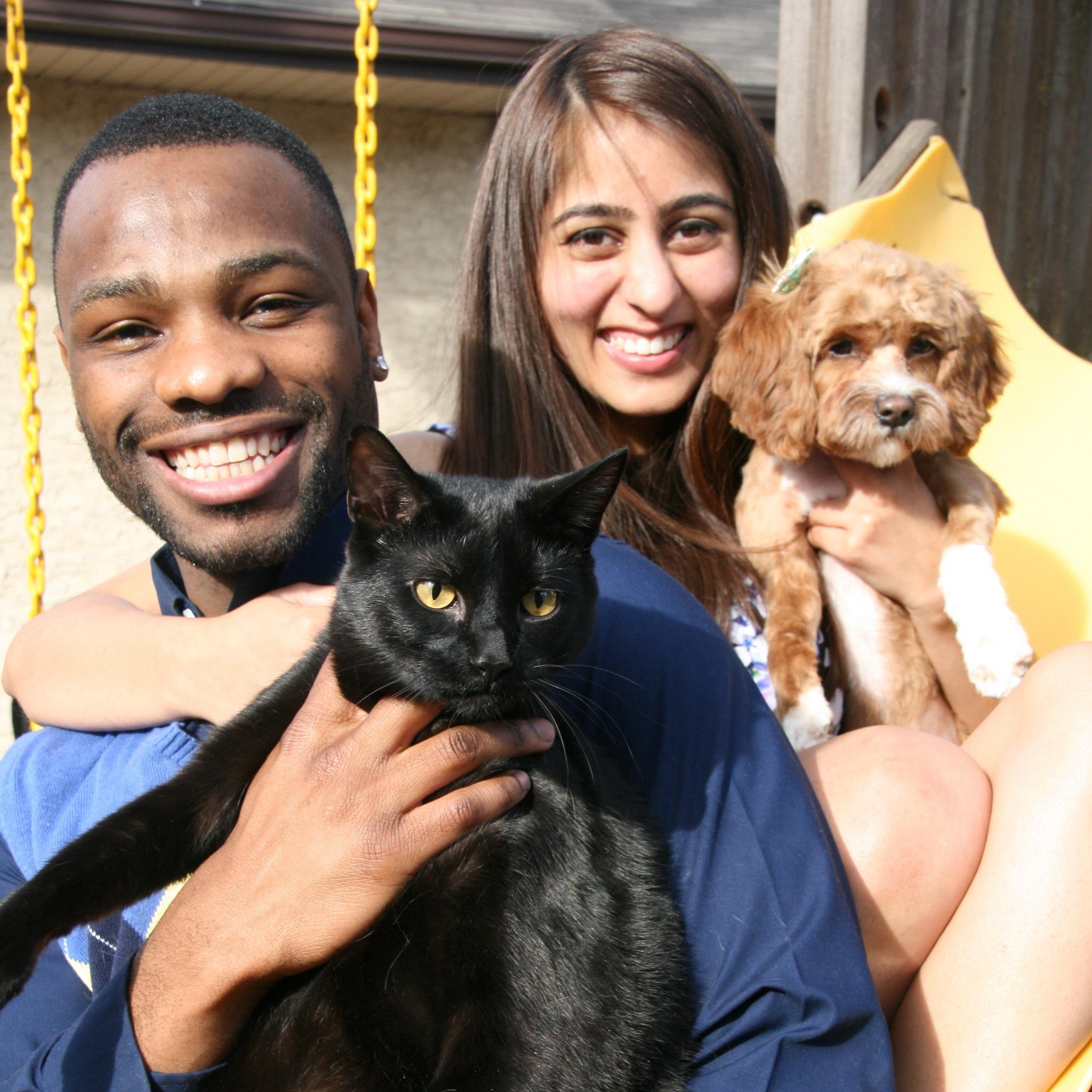 Yakasah with his wife, Esha and their cat (Mufasah) and dog (Kaira).