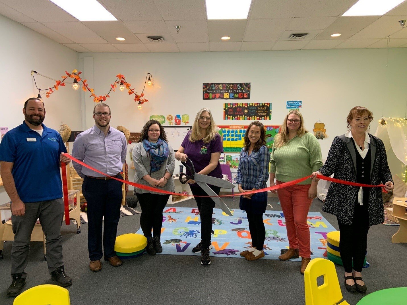 Greater Sandpoint Chamber of Commerce staff and ambassadors with Sandpoint Preschool Academy staff at their Ribbon Cutting on September 19, 2019.. From left to right: Steve Sanchez, Connor Currie, Caitlyn Hagen, Tana Vanderholm, Amy Bieda, Ricci Witte, Patricia Walker.
