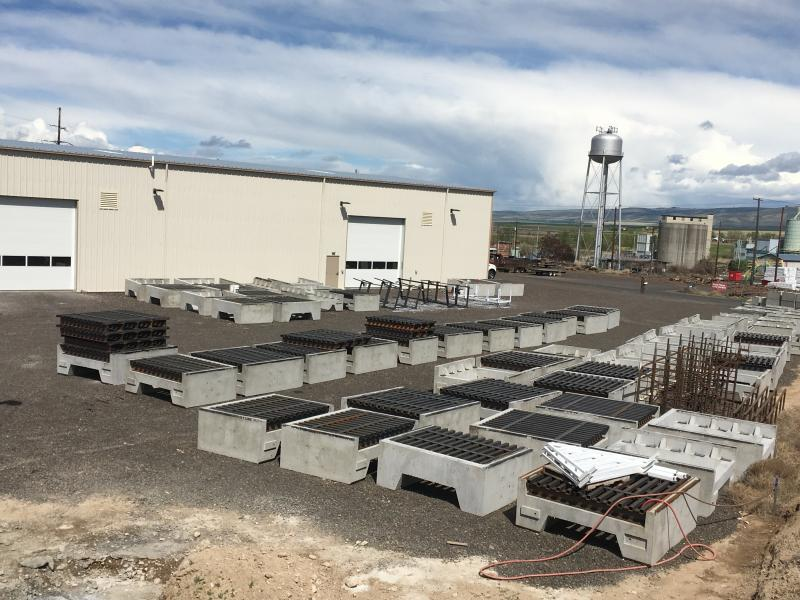 Precast concrete bases and steel cattle guards