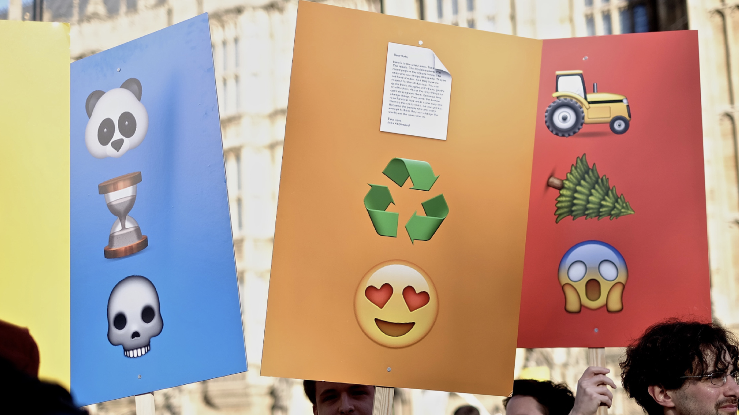 Protest placards made from the universal language of Emojis