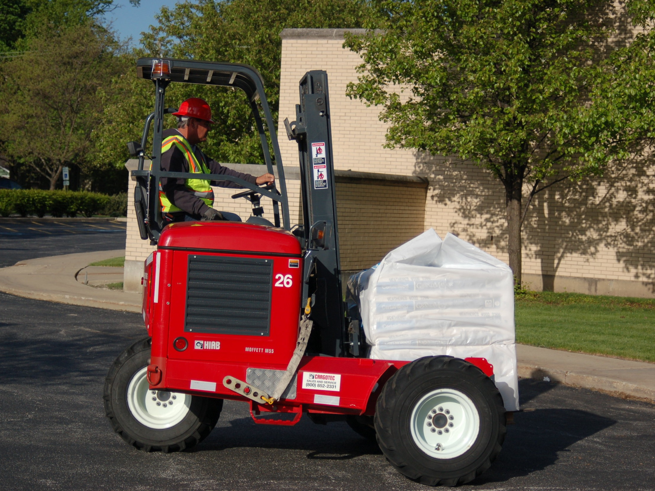 Moffett Delivery - Our truck mounted forklifts (Moffetts) allow our contractors to receive deliveries in the most remote of sites and locations not accessible by many other means. By utilizing a Moffett at the proper locations, material can be brought much closer to the jobsite, saving time and money for our roofers. The Moffett has a lifting capacity of 5500 lbs., all-wheel drive, and the ability to drive across rough terrain.
