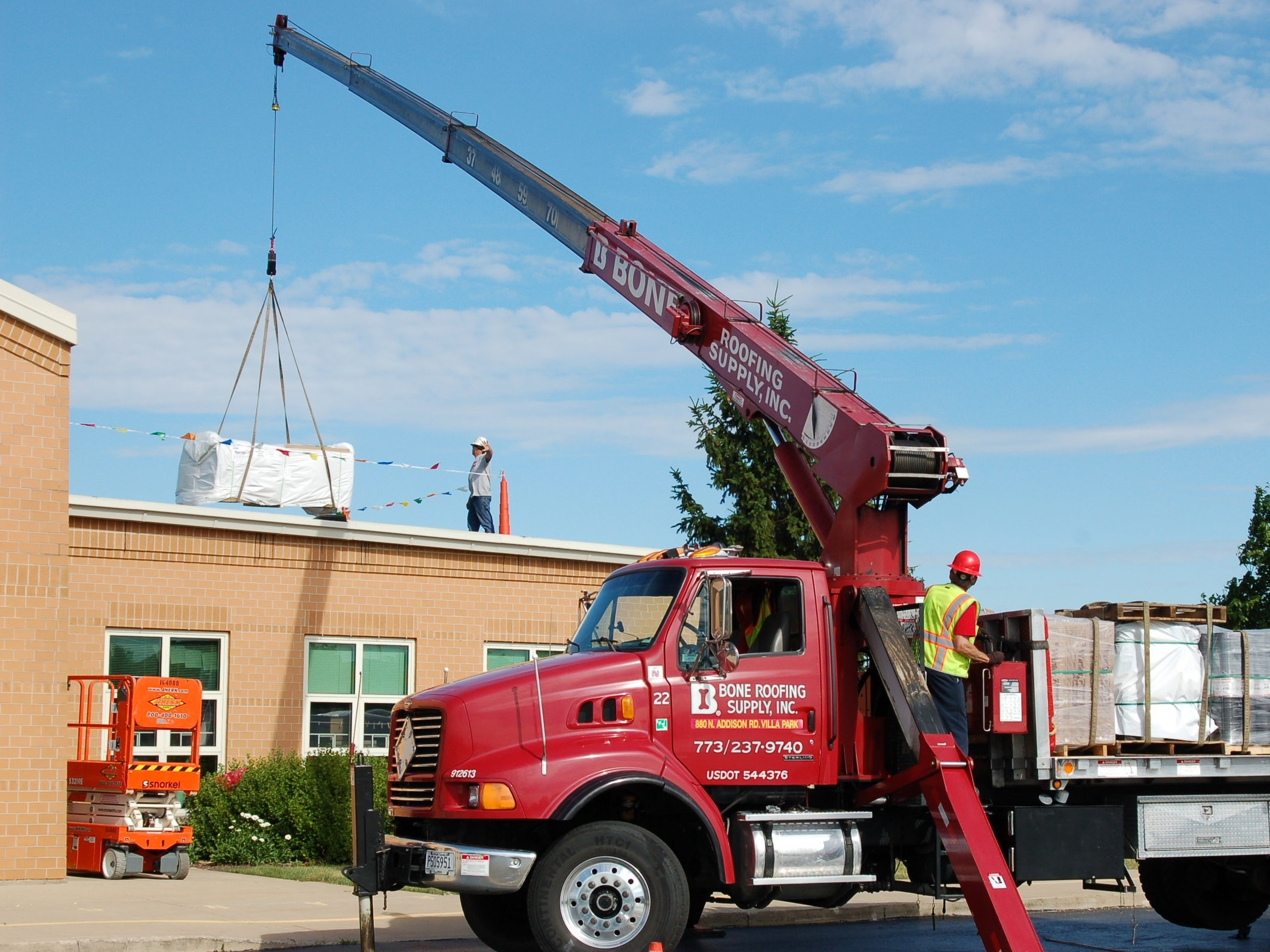 Rooftop Delivery - Whether it's a large job or a small one, getting a full set of roofing supplies placed on the roof is a service that we offer to our contractors. Our knuckle cranes can reach buildings of up to 3-stories while in the tightest of spots, while our stick cranes can reach up to 5-stories. Our cranes eliminate the need for the contractor to rent their own cranes at exacerbating rates to meet their needs.