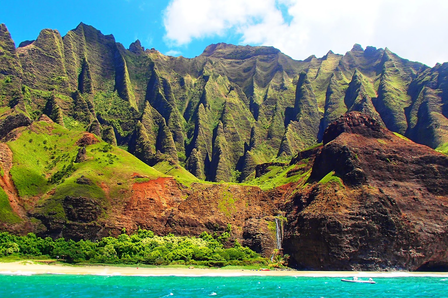 NA PALI COAST STATE WILDERNESS PARK - Nāpali Coast State Wilderness Park lies in the northwest of Kauai Island, Hawaii. It's known for its towering pali, or sea cliffs, punctuated by narrow valleys, streams and cascading waterfalls. The Kalalau Trail is a steep footpath running through the park, between nearby Ke'e Beach and sandy Kalalau Beach. It cuts through 5 valleys, including the Hanakoa Valley, with its native plants and old agricultural terraces.