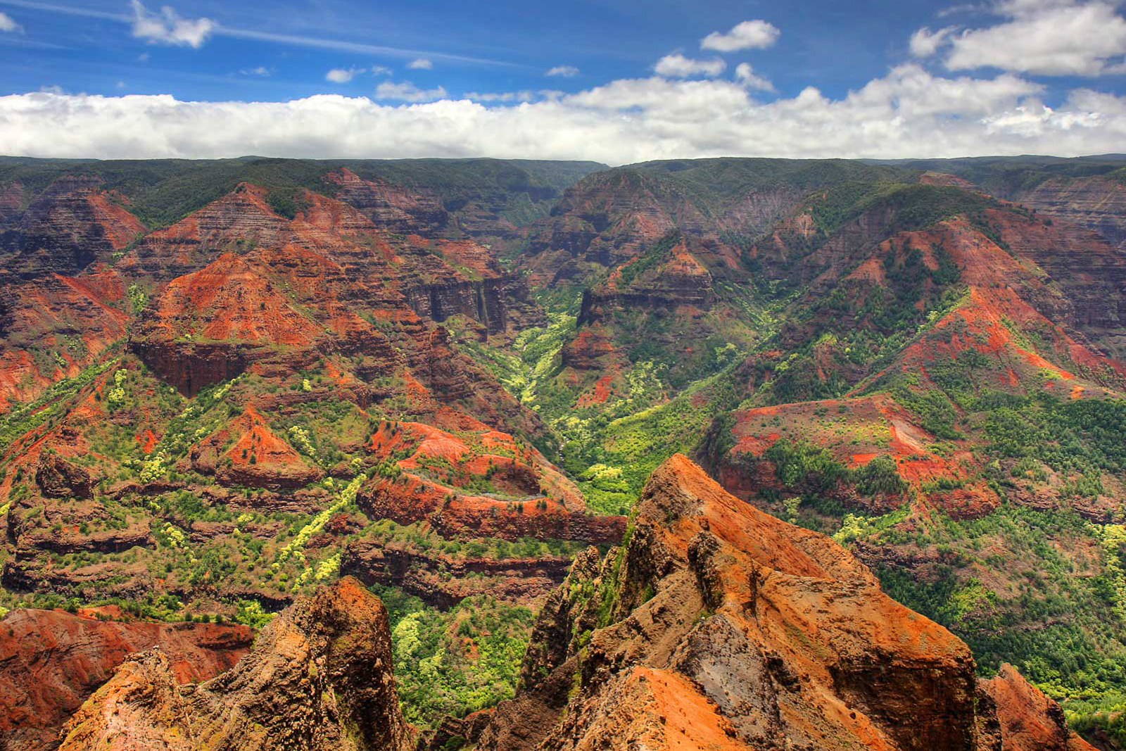 WAIMEA CANYON STATE PARK - Waimea Canyon, also known as the Grand Canyon of the Pacific, is a large canyon, approximately ten miles long and up to 3,000 feet deep, located on the western side of Kauaʻi in the Hawaiian Islands of the United States. Waimea is Hawaiian for