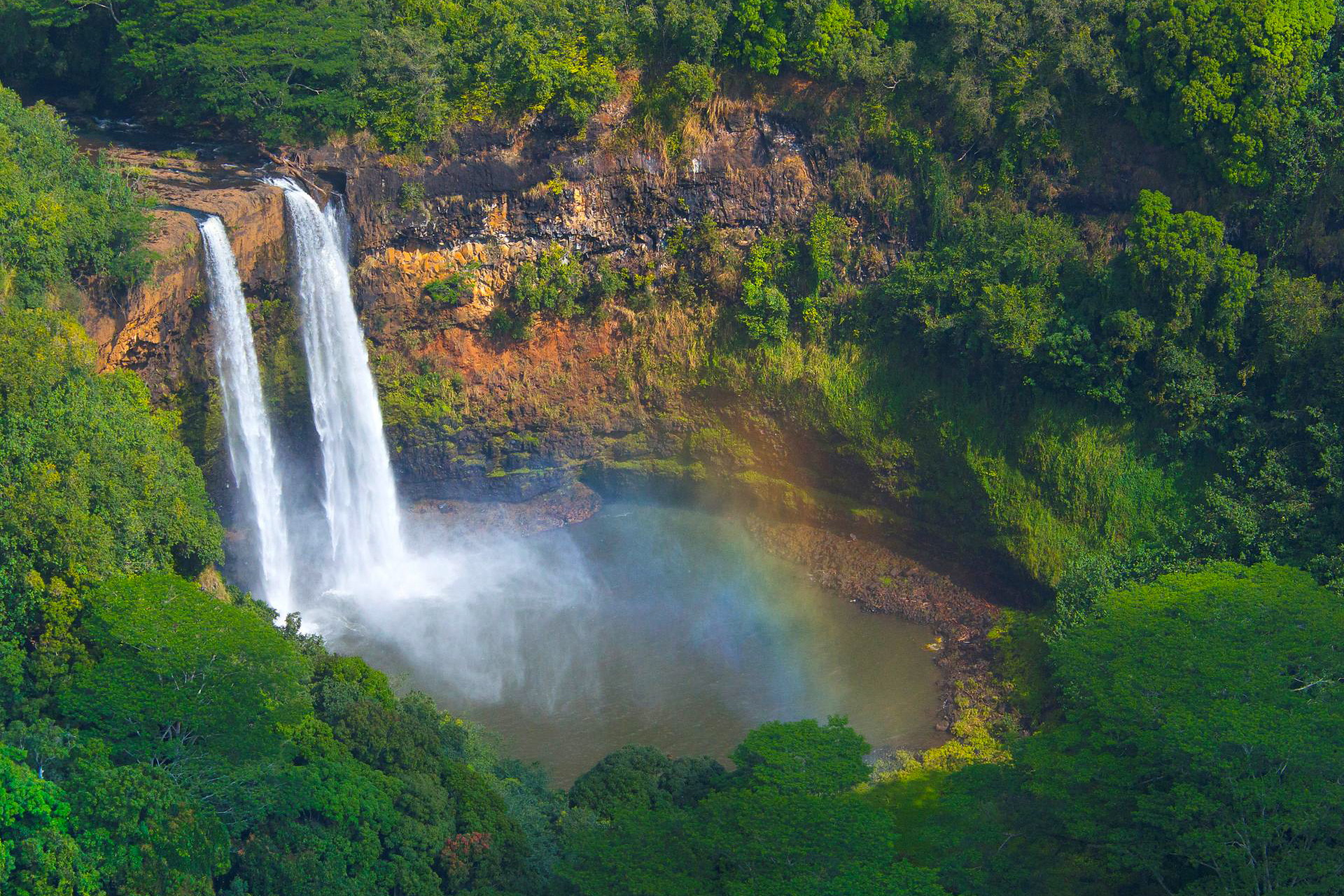WAILUA FALLS - Wailua Falls is a 173 foot waterfall located near Lihue that feeds into the Wailua River. The waterfall is prominently featured on the opening credits of the television series Fantasy Island. There are paths to the bottom of the falls, but it can be muddy and slippery.