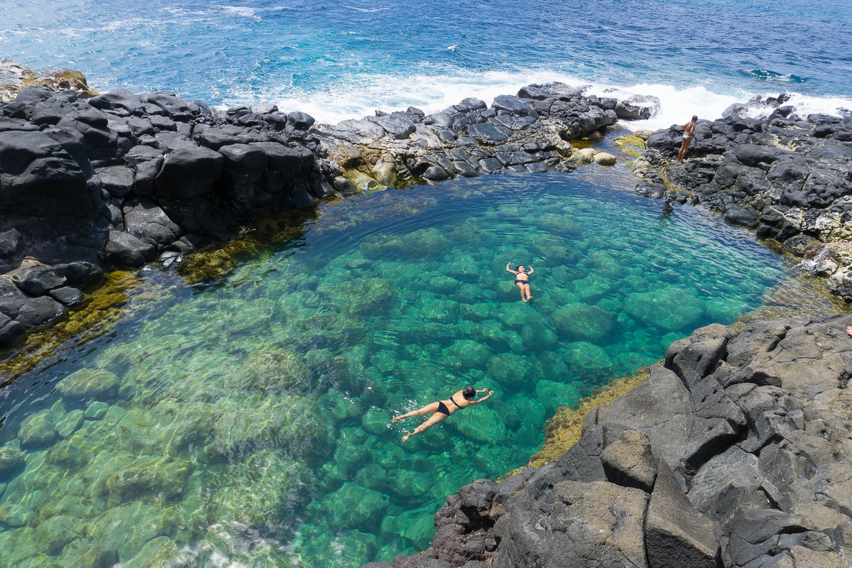 QUEEN'S BATH - Queen's Bath is a unique tide pool on the island of Kauaʻi, Hawaii. The pool is a sinkhole surrounded by igneous rock.